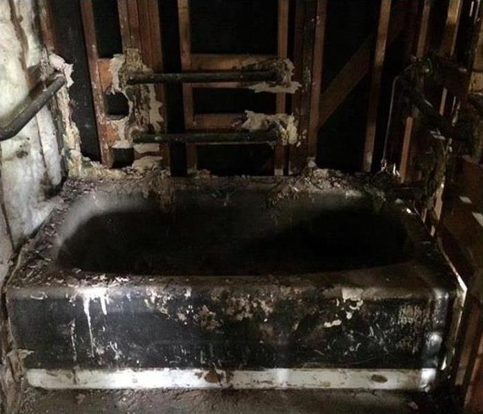 fire damaged bathroom covered in soot